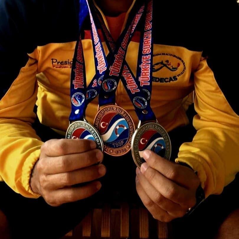 man holding medal awards